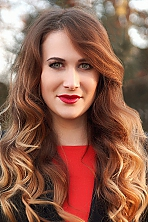 Ukrainian girl Nadezhda,30 years old with green eyes and light brown hair.