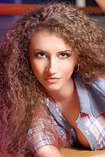 Ukrainian girl Alena,28 years old with grey eyes and light brown hair.