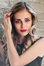 Ukrainian girl Daria,21 years old with green eyes and blonde hair.