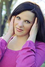 Ukrainian girl Olga,36 years old with green eyes and dark brown hair.