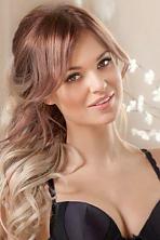 Ukrainian girl Anna,26 years old with hazel eyes and black hair.