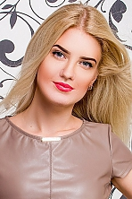 Ukrainian girl Olga,26 years old with green eyes and blonde hair.