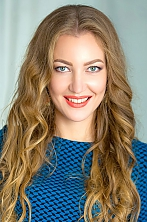 Ukrainian girl Anna,30 years old with green eyes and light brown hair.