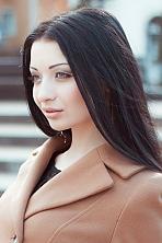 Ukrainian girl Anastasia,23 years old with green eyes and dark brown hair.