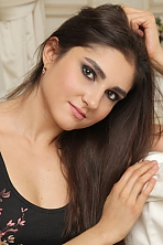 Ukrainian girl Lina,26 years old with brown eyes and dark brown hair.