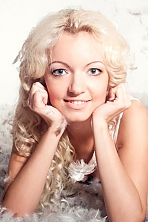 Ukrainian girl Elena,30 years old with hazel eyes and blonde hair.