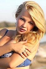 Ukrainian girl Liliya,23 years old with green eyes and blonde hair.