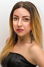 Ukrainian girl Mari,23 years old with brown eyes and light brown hair.