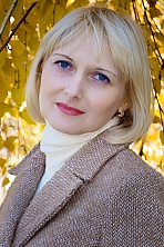 Ukrainian girl Oksana,42 years old with grey eyes and blonde hair.