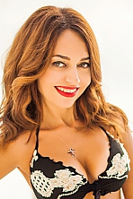 Ukrainian girl Ludmila,44 years old with green eyes and light brown hair.