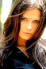 Ukrainian girl Olga,27 years old with hazel eyes and black hair.