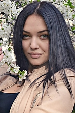 Ukrainian girl Yuliya,20 years old with grey eyes and black hair.