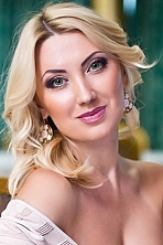 Ukrainian girl Inna,39 years old with grey eyes and blonde hair.