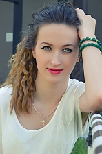Ukrainian girl Irina,22 years old with green eyes and light brown hair.