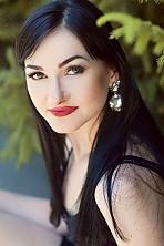 Ukrainian girl Inna,21 years old with grey eyes and black hair.