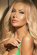 Ukrainian girl Svetlana,31 years old with green eyes and blonde hair.