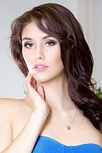 Ukrainian girl Caroline,21 years old with green eyes and dark brown hair.