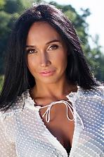 Ukrainian girl Vita,36 years old with hazel eyes and black hair.
