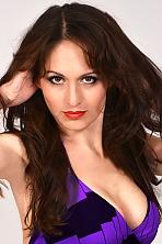 Ukrainian girl Marina,35 years old with brown eyes and dark brown hair.
