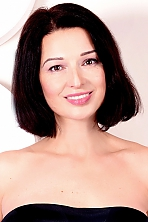 Ukrainian girl Ludmila,43 years old with brown eyes and dark brown hair.