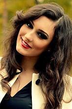 Ukrainian girl Galina,22 years old with green eyes and black hair.