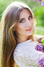 Ukrainian girl Elina,19 years old with grey eyes and light brown hair.