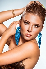Ukrainian girl Irina,27 years old with green eyes and dark brown hair.