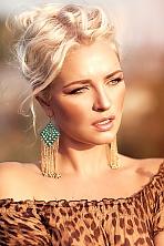 Ukrainian girl Kseniya,35 years old with blue eyes and blonde hair.