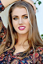 Ukrainian girl Julia,25 years old with green eyes and light brown hair.