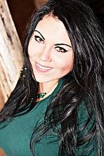 Ukrainian girl Yuliya,24 years old with green eyes and black hair.
