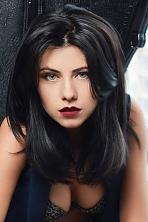 Ukrainian girl Oksana,26 years old with green eyes and dark brown hair.