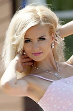 Ukrainian girl Bohdana,31 years old with blue eyes and blonde hair.