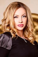 Ukrainian girl Ruslana,26 years old with grey eyes and blonde hair.