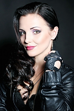 Ukrainian girl Marina,32 years old with brown eyes and dark brown hair.