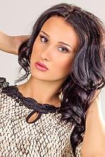 Ukrainian girl Anna,21 years old with hazel eyes and black hair.