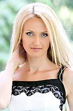 Ukrainian girl Viktoriya,38 years old with grey eyes and blonde hair.