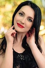 Ukrainian girl Olga,39 years old with green eyes and dark brown hair.