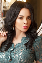 Ukrainian girl Lina,44 years old with brown eyes and black hair.