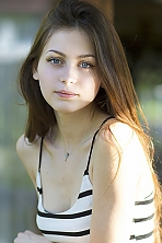 Ukrainian girl Christina,19 years old with grey eyes and dark brown hair.