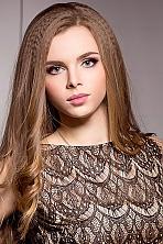 Ukrainian girl Elena,23 years old with grey eyes and auburn hair.
