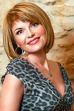 Ukrainian girl Alla,41 years old with brown eyes and light brown hair.