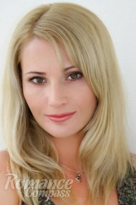 Ukrainian girl Nataliya,33 years old with brown eyes and blonde hair.