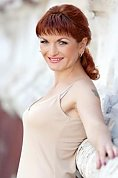 Ukrainian girl Valentina,39 years old with grey eyes and red hair.