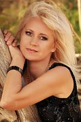 Ukrainian girl Ludmila,50 years old with blue eyes and blonde hair.