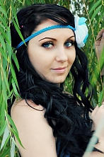 Ukrainian girl Julia,28 years old with blue eyes and dark brown hair.