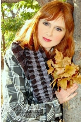 Ukrainian girl Tatyana,46 years old with grey eyes and red hair.