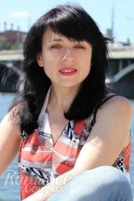 Ukrainian girl Irina,37 years old with green eyes and black hair.