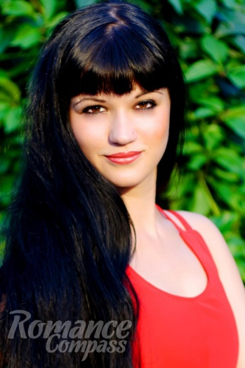 Ukrainian girl Yaroslava,28 years old with hazel eyes and black hair.