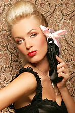 Ukrainian girl Olga,34 years old with green eyes and blonde hair.