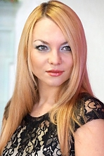 Ukrainian girl Valeria,30 years old with green eyes and red hair.